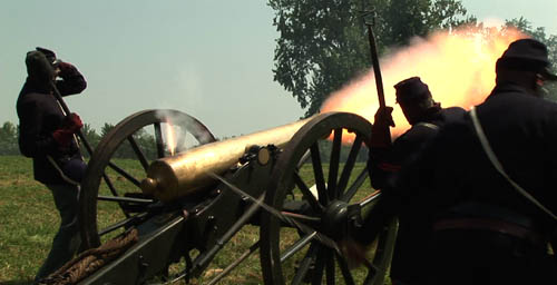 Black soldiers firing cannon